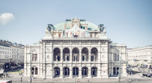 The Vienna State Opera with round arches in the facade and a cupola.