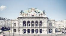 Das Gebäude der Wiener Staatsoper mit Rundbögen in der Fassade und Kuppel.