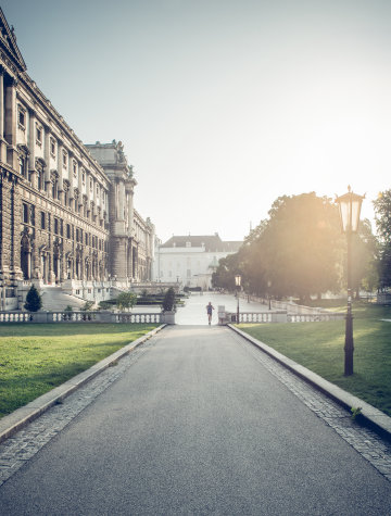 The Hofburg with the surrounding park at sunrise.