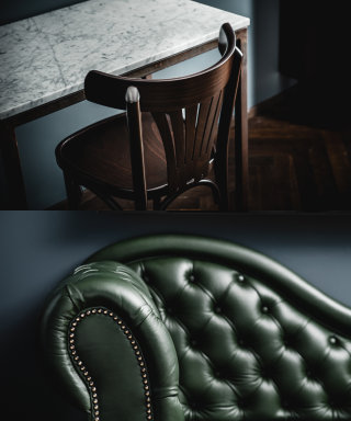 Fine dark wooden chair and a leather chaiselongue in the Grand Ferdinand business room.