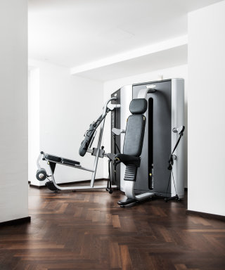 Modern fitness area with a variety of exercise equipment.