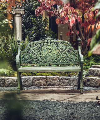 Green metal bench with eleborate ornaments at the Grand Ferdinand oasis.