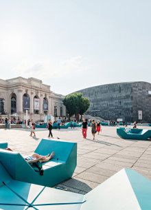 The Kunsthalle Wien at the MuseumsQuartier and turquoise design furniture in the front.